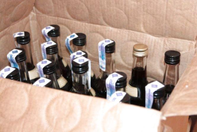 Двох чоловіків судитимуть за виробництво підробного алкоголю у Кам'янці